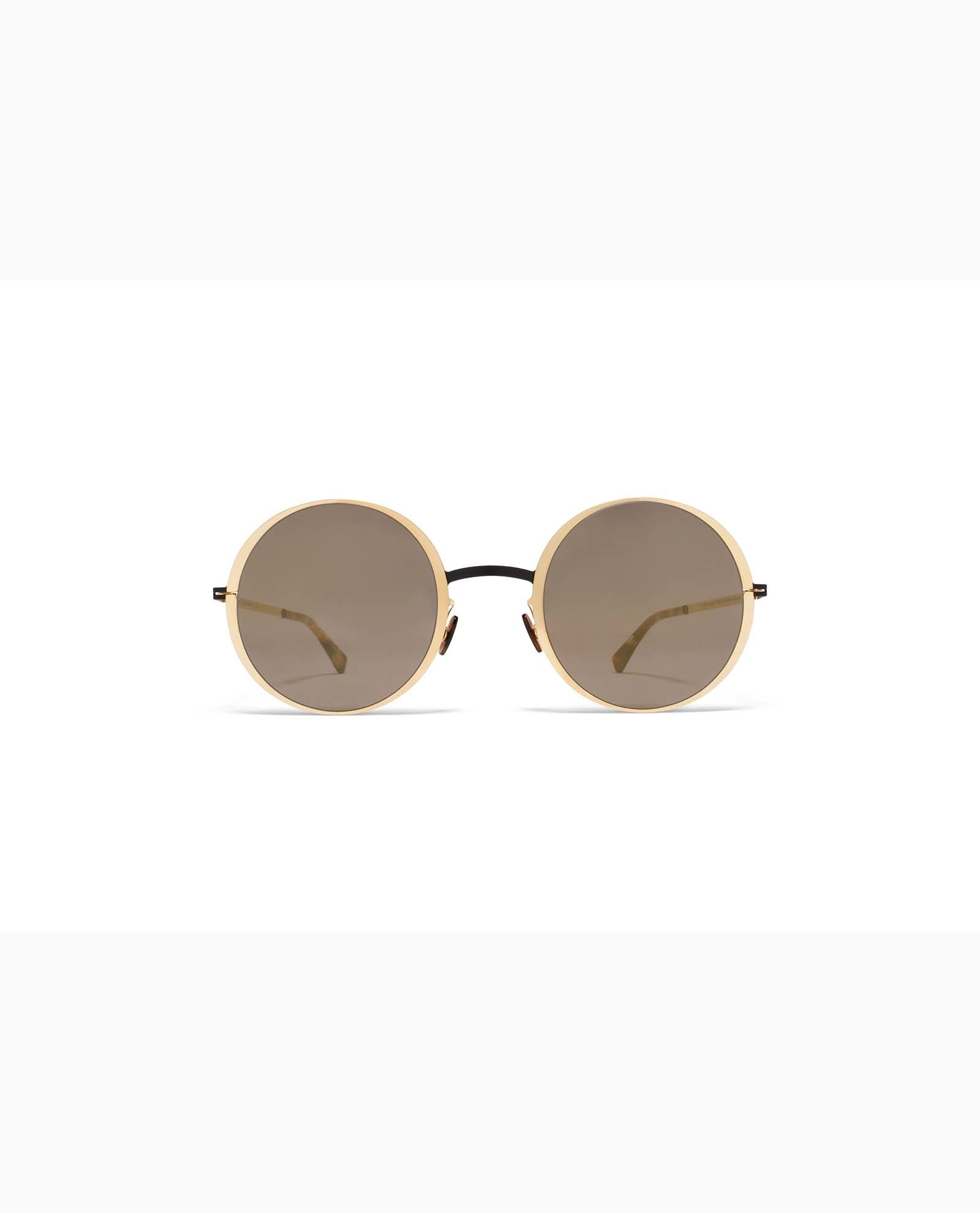 https://www.polydoruoptika.gr/wp-content/uploads/2018/05/mykita-lite-acetate-sun-joona-gold-black-brilliant-2-woman.jpg