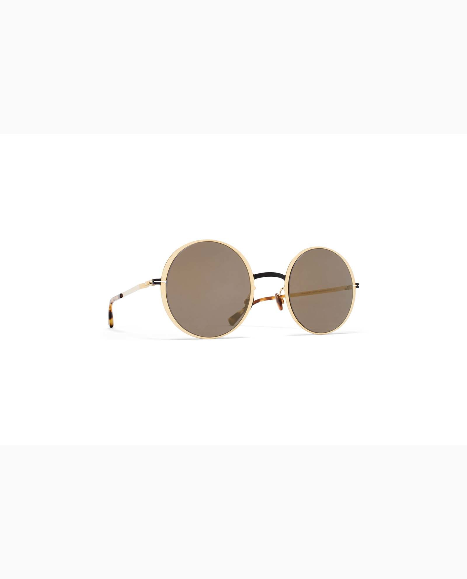 https://www.polydoruoptika.gr/wp-content/uploads/2018/05/mykita-lite-acetate-sun-joona-gold-black-brilliant-woman.jpg
